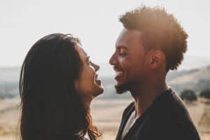 man and woman facing